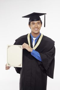man-in-graduation-robe-holding-blank-certificate