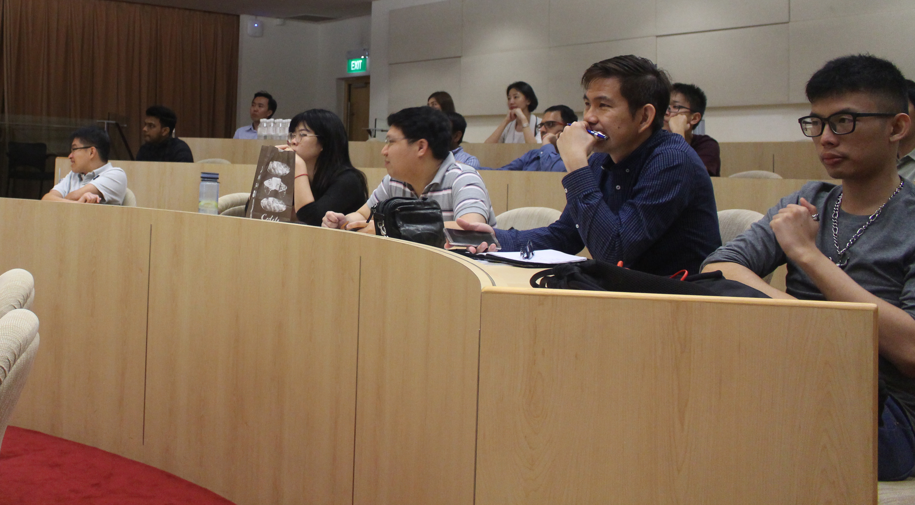 Attendees listening intently to cybersecurity expert, Loi Liang Yang's presentation.